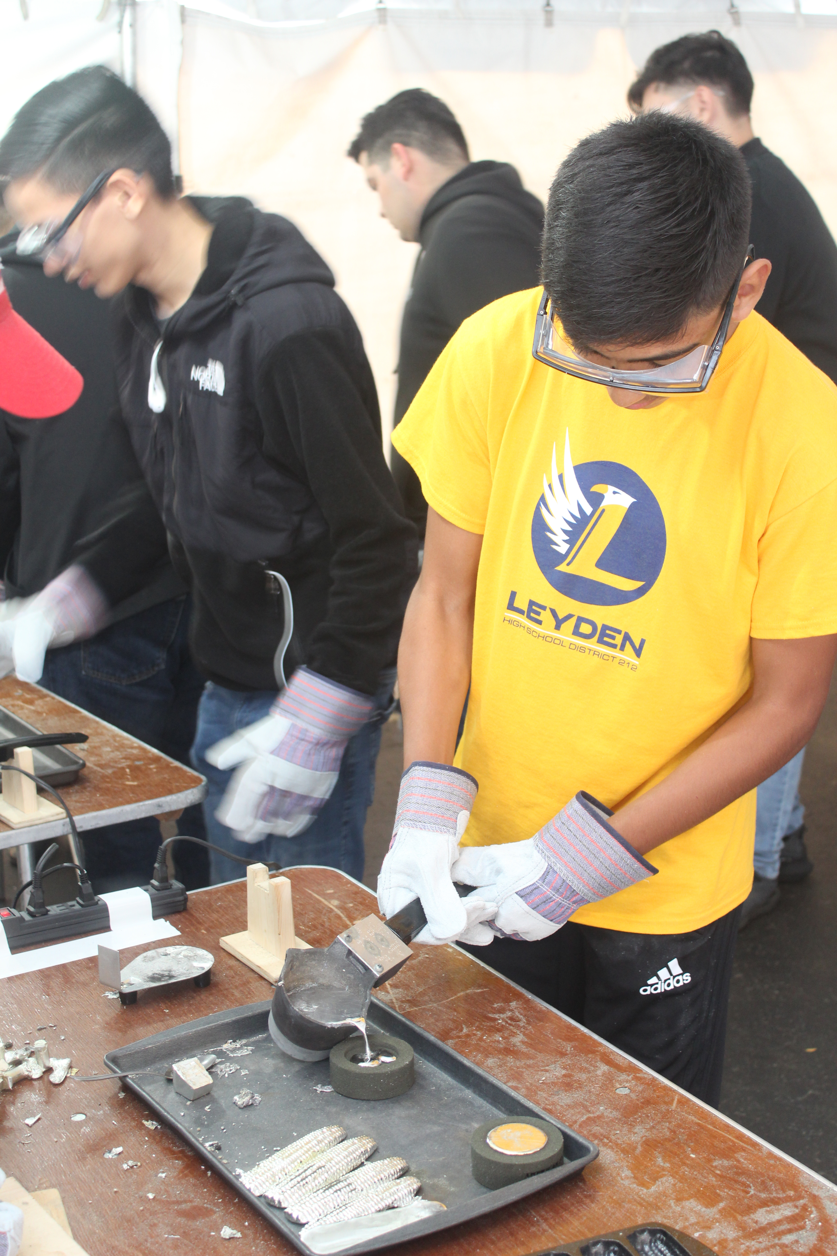 Student pouring tin
